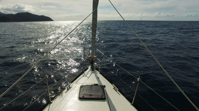 sail boat in the sea under sunshine - boat point of view stock videos & royalty-free footage
