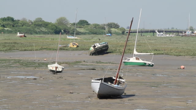 sail boats at low tide, wide shot - low tide stock videos & royalty-free footage