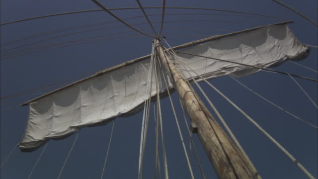 ms sail boat's mainsail unfurling and sail rigging moving / crete, greece - sail stock videos and b-roll footage