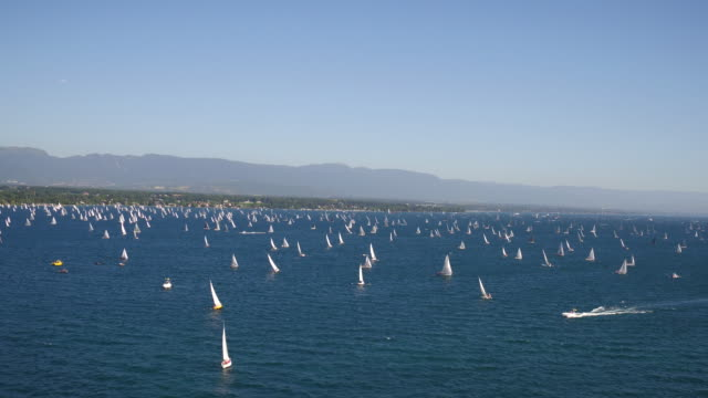 sail boats on the lake geneva - sailing stock videos & royalty-free footage