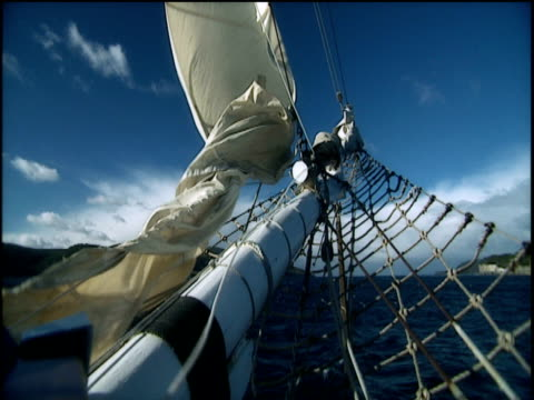 sail of jib boom on two masted brig sailing ship blows and fills in the breeze tasmania - menschliche gliedmaßen stock-videos und b-roll-filmmaterial