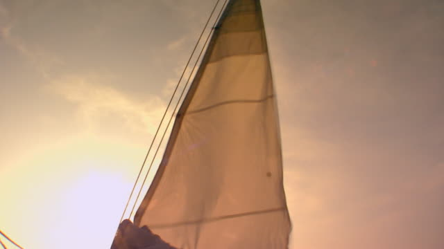 sail on boat at sunset, handheld - sailing boat stock videos & royalty-free footage