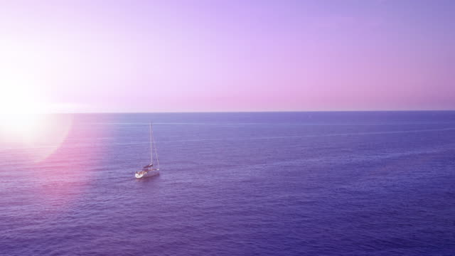 Sailboat alone on the Mediterranean Sea