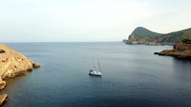sailboat anchored in the coast - anchored stock videos & royalty-free footage
