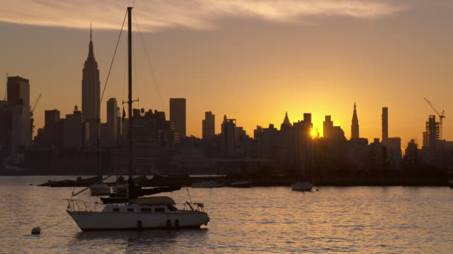 sailboat anchored in the hudson river at sunrise - anchored stock videos & royalty-free footage