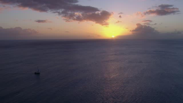 sailboat at sea under setting sun. - yacht stock videos & royalty-free footage