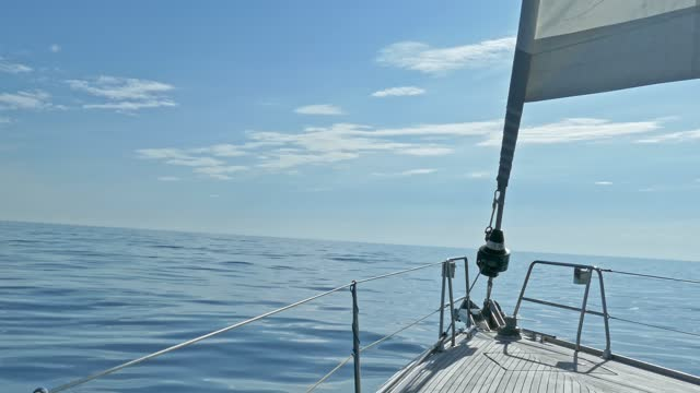 sailboat bow in tranquil waters of calm sea in the atlantic ocean. view of sail and rigs - ship's bow stock videos & royalty-free footage