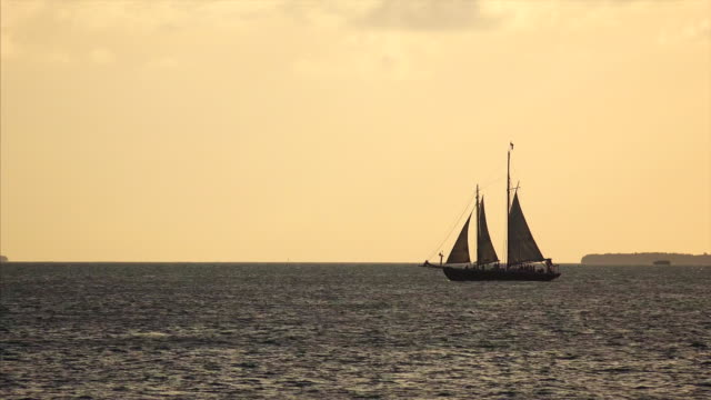 Sailboat charter tour  filled with tourists off the coast of Key West, Florida