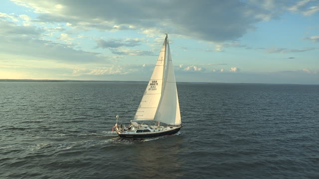 A sailboat cruises leisurely on Long Island Sound.