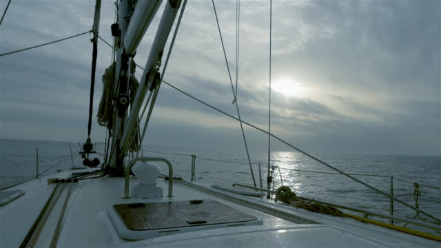sailboat deck while sailing on sunrise - portello video stock e b–roll