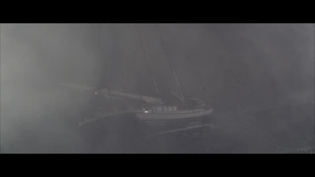 ms sailboat floating on sea in storm - small boat stock videos & royalty-free footage