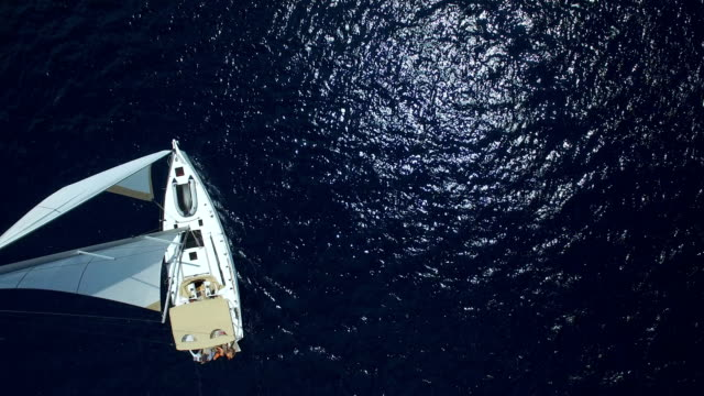 sailboat from above, shot from drone - nave a vela video stock e b–roll