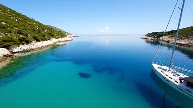 aerial sailboat in a beautiful adriatic lagoon - adriatic sea stock videos & royalty-free footage