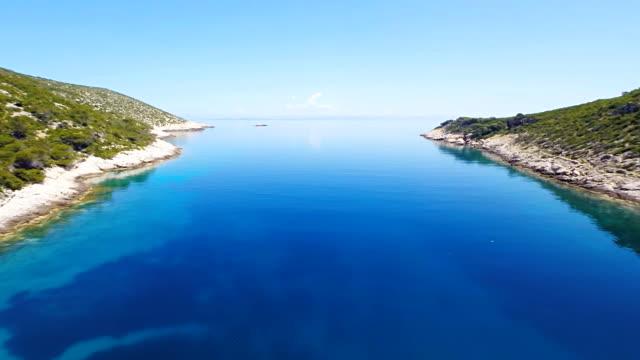 AERIAL Sailboat In A Beautiful Bay