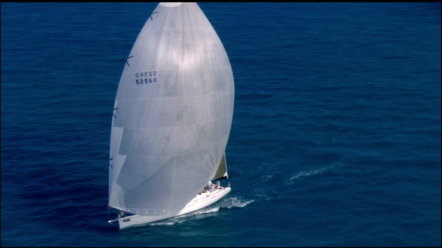 low aerial, sailboat in ocean, key west, florida, usa - sailing boat stock videos & royalty-free footage