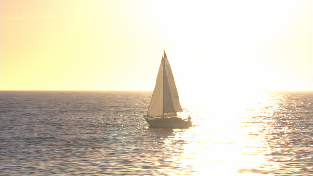 sailboat in pacific ocean sunset - yacht stock videos & royalty-free footage