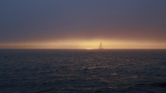 Sailboat in the Fog Wrapped Sunset