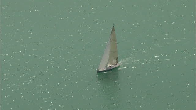 aerial sailboat on lake woerthersee, carinthia, austria - carinthia stock videos & royalty-free footage