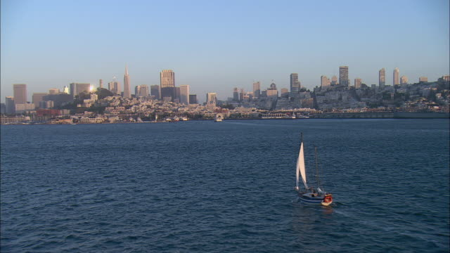 stockvideo's en b-roll-footage met aerial sailboat on san francisco bay and san francisco cityscape with pier 39, california, usa - pier 39