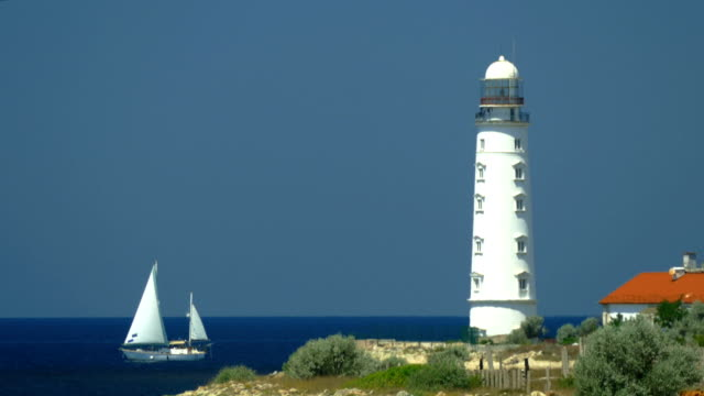sailboat regatta against the backdrop of the lighthouse - russia stock videos & royalty-free footage