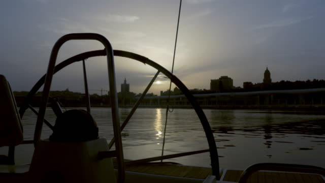 Sailboat Rudder and Malaga Skyline at sunset