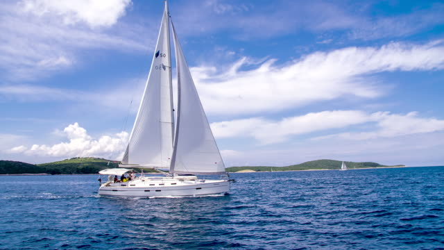 ws sailboat sailing along the coastline - sailing stock videos & royalty-free footage
