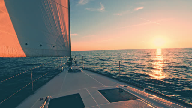 ws sailboat sailing at sunset - nautical vessel stock videos & royalty-free footage