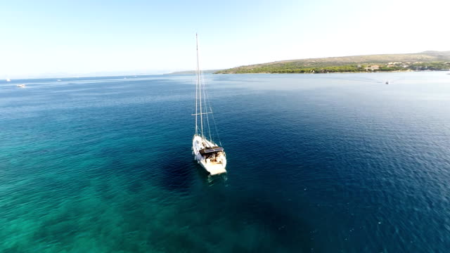 aerial sailboat sailing in the bay - yachting stock videos and b-roll footage
