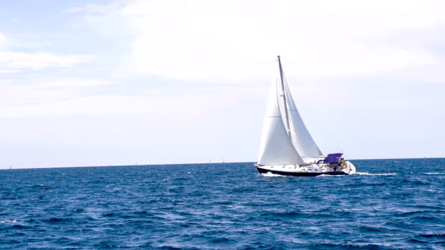 ls sailboat sailing on the open sea - sailing boat stock videos & royalty-free footage