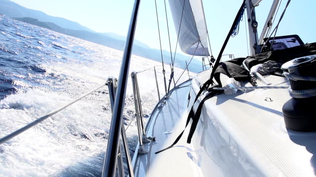 slo mo sailboat sailing on the sea - sailing stock videos and b-roll footage
