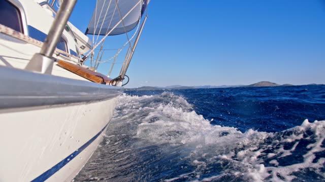 slo mo sailboat sailing the sea - recreational boat stock videos & royalty-free footage