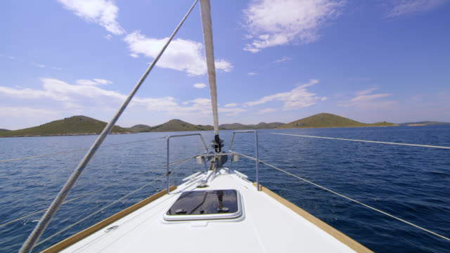 ws sailboat sailing to the island - approaching stock videos & royalty-free footage