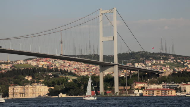 ws la sailboat sailing underneath bosphorus bridge, istanbul, turkey - july 15 martyrs' bridge stock videos & royalty-free footage