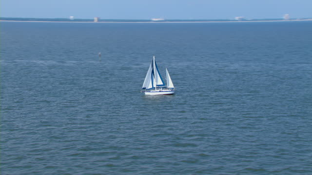 A sailboat sails in the Gulf of Mexico.