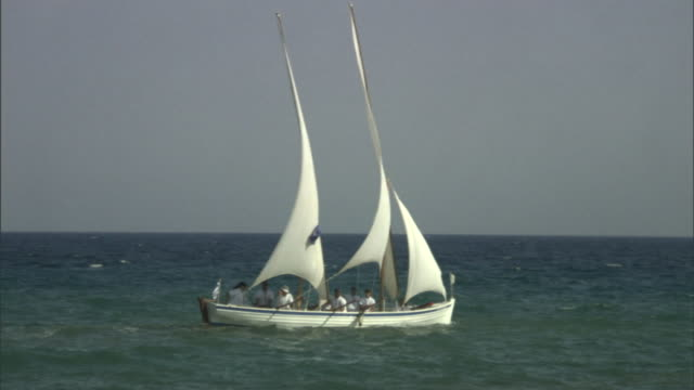 a sailboat with a greek flag catches wind on the mediterranean sea. - greek flag stock videos & royalty-free footage