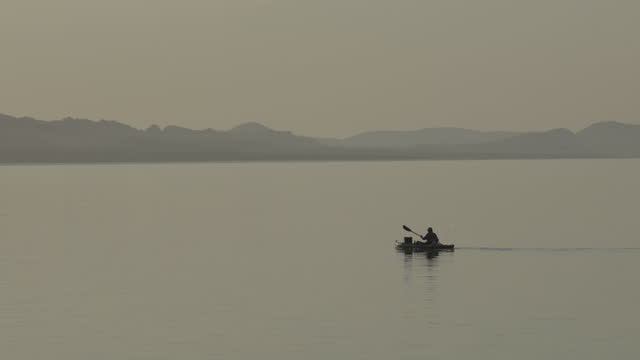 sailboat,kayakers and fisherman at sunrise - using a paddle stock videos & royalty-free footage