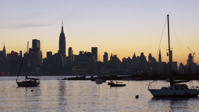 sailboats anchored in the hudson river in the early morning - anchored stock videos & royalty-free footage
