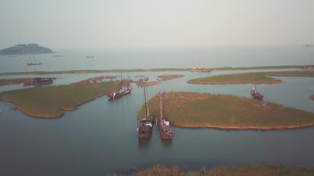 AERIAL Sailboats and islands on Lake Tai, Suzhou, Jiangsu Province, China