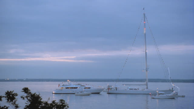 sailboats and yachts moor just off the north shore of long island. - golden hour stock videos & royalty-free footage