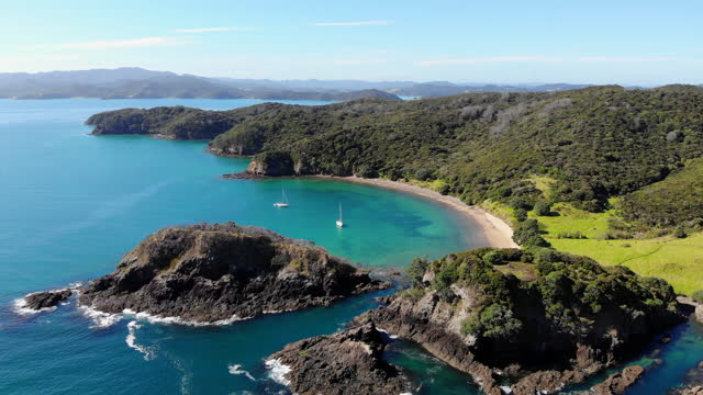 sailboats at anchor in bay of islands, nz - bay of islands new zealand stock videos & royalty-free footage