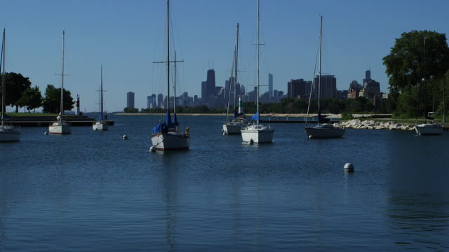 sailboats docked on lake michigan with the chicago skyline in the background - lockdown stock videos & royalty-free footage