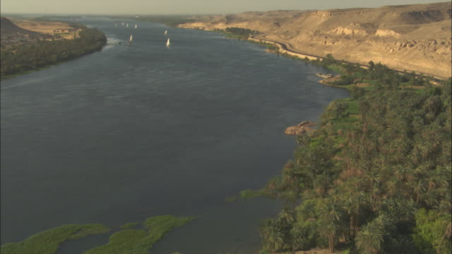 sailboats float on the river nile in egypt. - river nile stock videos & royalty-free footage