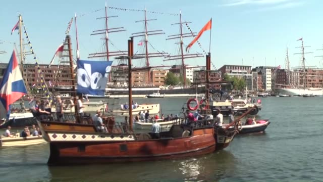 sailboats flotilla of tall ships maritime heritage naval ships and impressive replicas attend to sail amsterdam in netherlands on august 20 2015 sail... - sailing ship stock videos & royalty-free footage