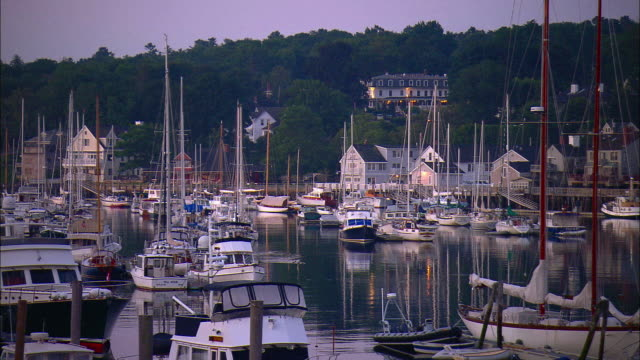 ms, pan, sailboats in harbor at sunrise, camden, maine, usa - jachthafen stock-videos und b-roll-filmmaterial