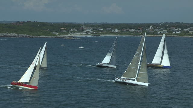 sailboats in narragansett bay form a starting line for the transatlantic race from newport, rhode island to cornwall, england. - regatta stock videos & royalty-free footage