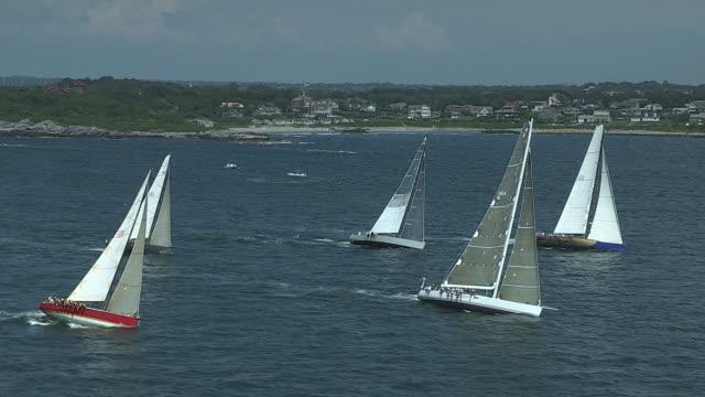 sailboats in narragansett bay form a starting line for the transatlantic race from newport, rhode island to cornwall, england. - regatta stock-videos und b-roll-filmmaterial