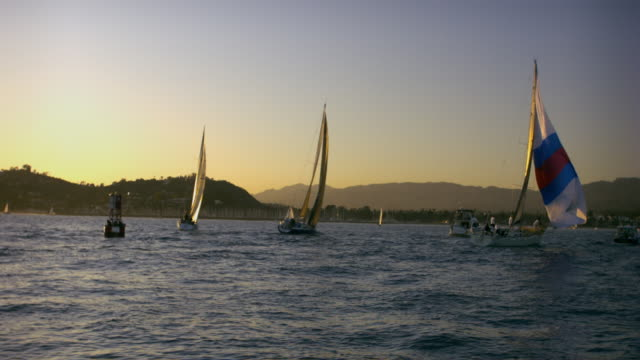 WS Sailboats in ocean, mountains in background, Santa Barbara, California, USA