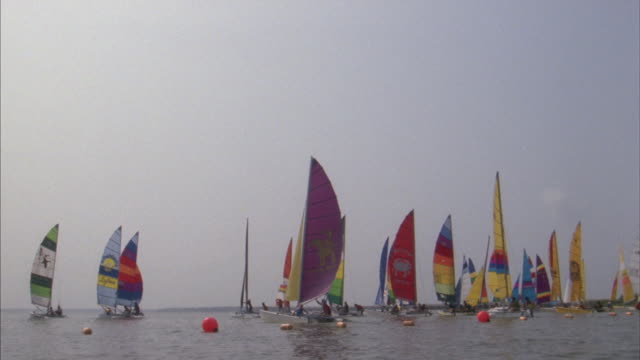 sailboats line up on the ocean for a regatta in maryland. - regatta stock videos & royalty-free footage