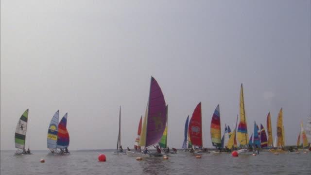 sailboats line up on the ocean for a regatta in maryland. - regatta stock-videos und b-roll-filmmaterial