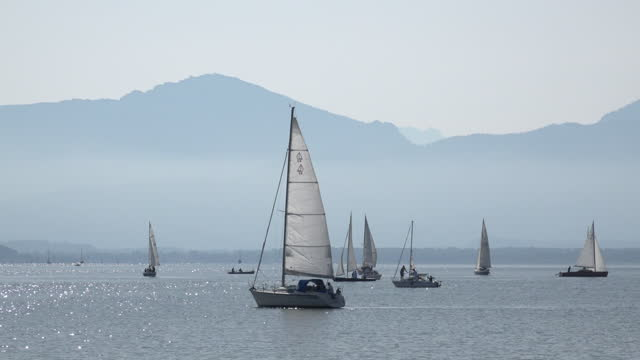 sailboats on lake chiemsee - bavarian alps stock videos & royalty-free footage